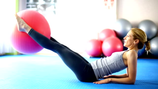 woman doing abs. - fitness ball stock videos & royalty-free footage