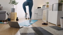 SLO MO Woman doing an online exercise training