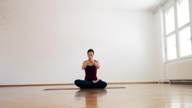 woman doing ashtanga yoga - yoga studio stock videos & royalty-free footage
