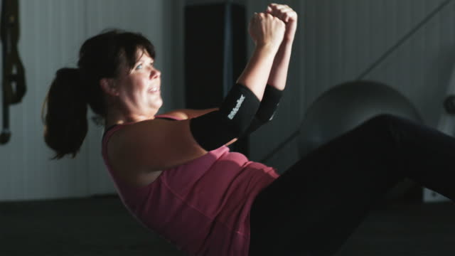 woman doing crunches   - large stock videos & royalty-free footage