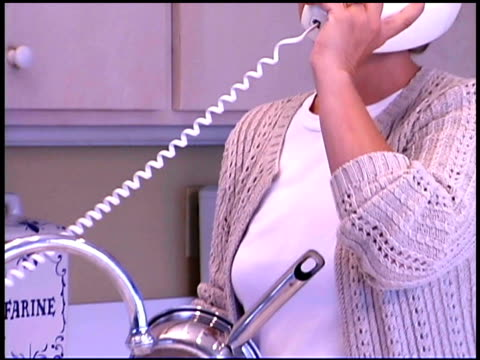 woman doing dishes and talking on the phone - landline phone stock videos & royalty-free footage