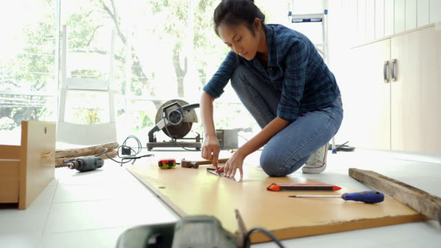 woman doing diy work, assembling furniture at home - bricolage video stock e b–roll
