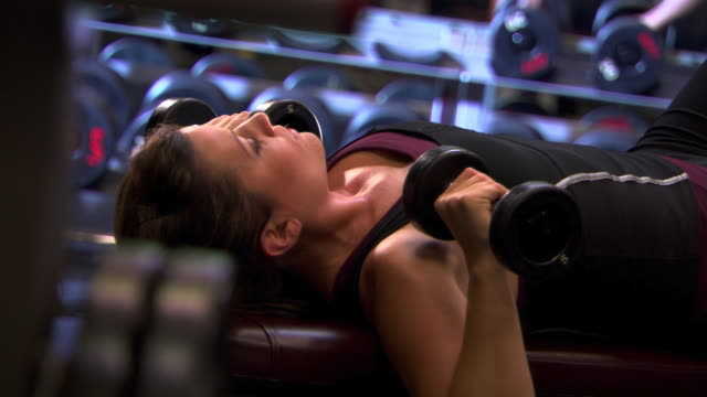 woman doing dumbbell presses - see other clips from this shoot 1272 stock videos and b-roll footage