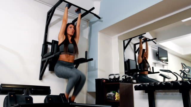 woman doing exercise for her abs - lateral pull down weights stock videos & royalty-free footage