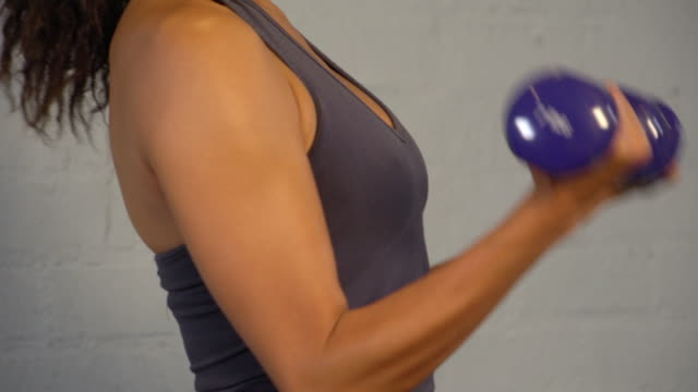 """cu woman doing exercise of arm curls with weight / beverly hills, california, united states"" - arm curl stock videos & royalty-free footage"