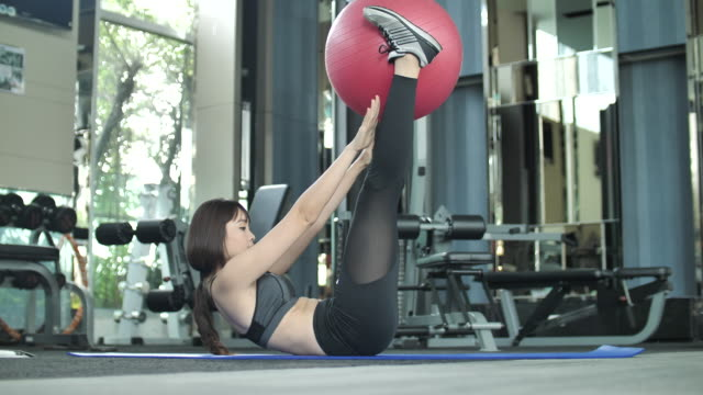 woman doing exercising with fitness ball - pallone per fitness video stock e b–roll