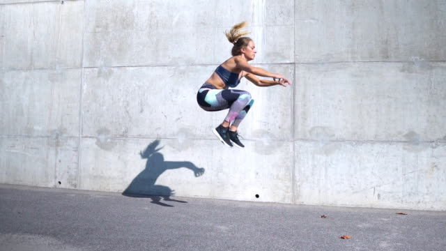 woman doing frog jumps - jumping stock videos & royalty-free footage