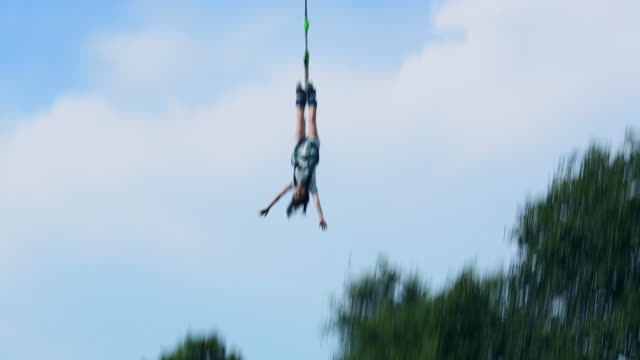 woman doing fun and fear adventure bungee jumping from high up - pattaya stock videos & royalty-free footage