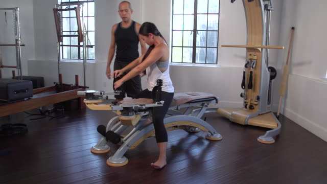 """ms woman doing gyrotonics exercise upper body with instructor, back / beverly hills, california, united states"" - pilates stock videos and b-roll footage"