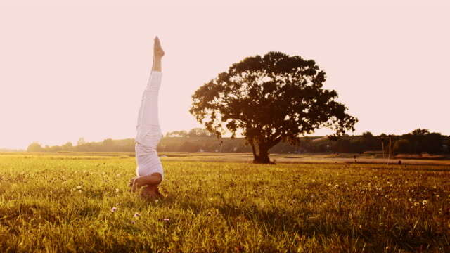 DS Woman doing headstand yoga exercises