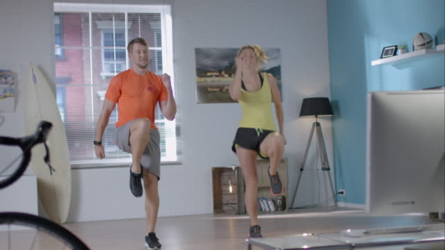 Woman doing her workout with personal trainer