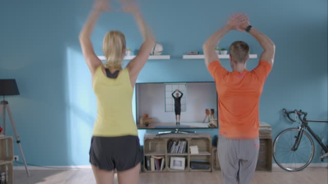 woman doing her workout with personal trainer - aerobics stock videos & royalty-free footage