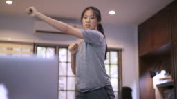 Woman Doing Hiit Dance Online Training Session at home in covid-19 corona virus situation