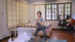 Woman Doing Jumping Jack Hiit Exercise Online Training Session at home in covid-19 corona virus situation