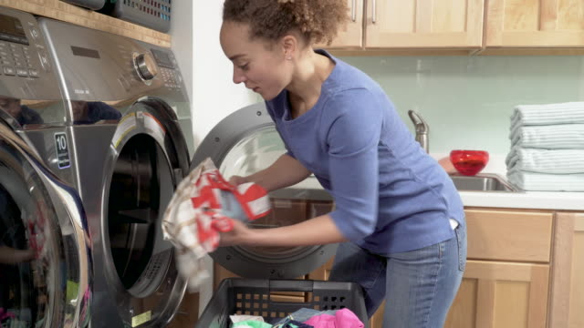 woman doing laundry at home - appliance stock videos and b-roll footage