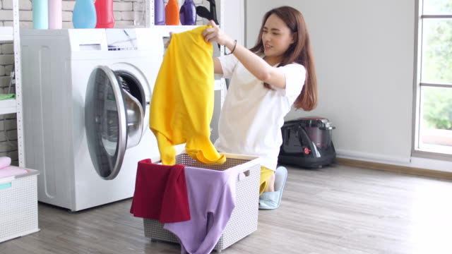 woman doing laundry with washing machine at home - tumble dryer stock videos & royalty-free footage