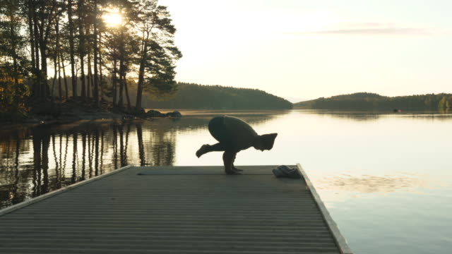 woman doing morning yoga in autumn colors - spirituality stock videos & royalty-free footage