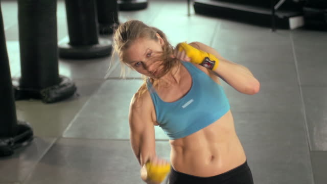 woman doing muay thai/kickboxing training at the gym. - slow motion - kickboxing stock videos & royalty-free footage
