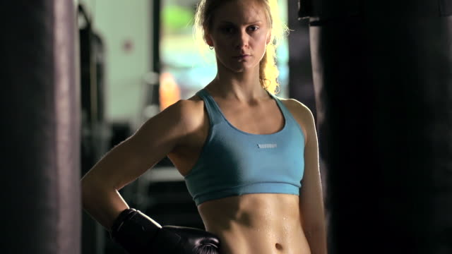 woman doing muay thai/kickboxing training at the gym. - slow motion - kickboxing stock videos and b-roll footage