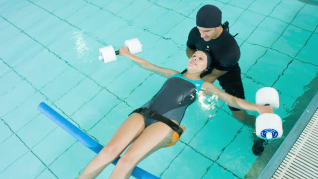 woman doing physical therapy in the water - physiotherapy stock videos & royalty-free footage