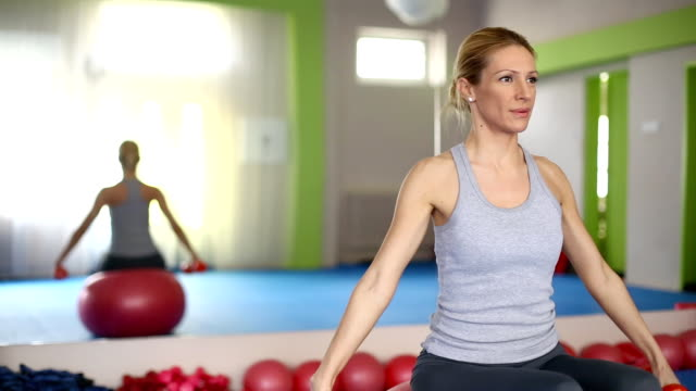 Woman doing Pilates exercises.