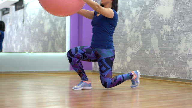 woman doing pilates in gym - fitness ball stock videos & royalty-free footage