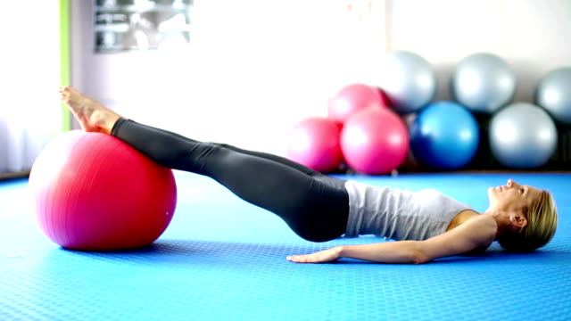 woman doing pilates. - spandex stock videos & royalty-free footage