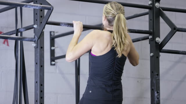 woman doing pull ups - fatcamera stock videos and b-roll footage