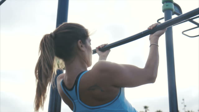woman doing pull-ups - chin ups stock videos and b-roll footage