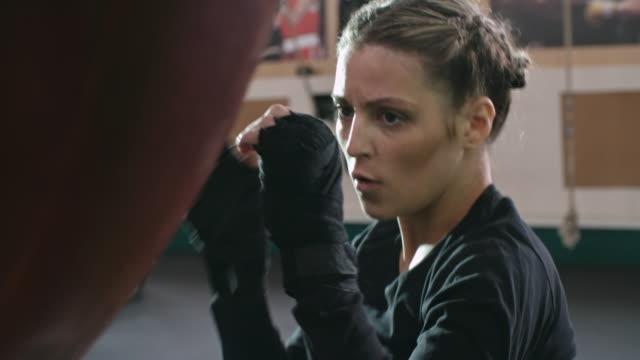 Woman doing punching bag workout