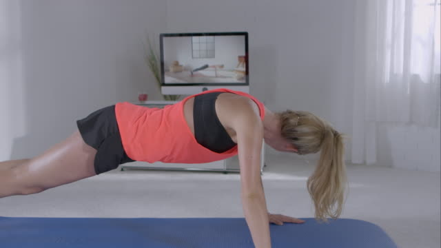 Woman doing pushups for her workout
