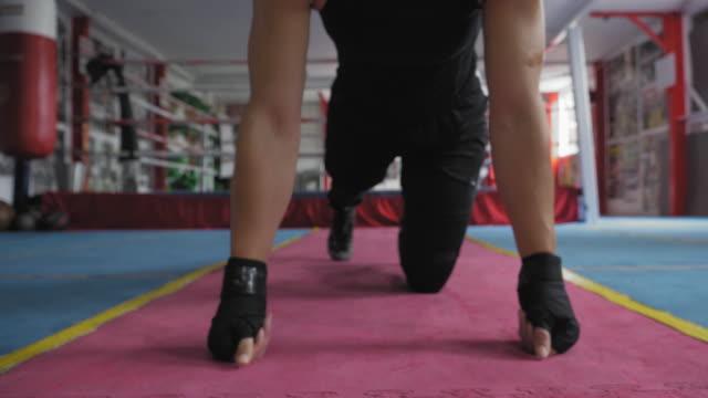 woman doing push-ups - push ups stock videos & royalty-free footage