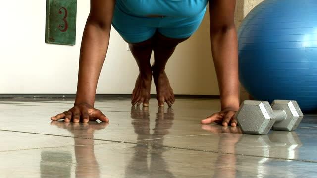 woman doing push-ups - bodyweight training stock videos & royalty-free footage