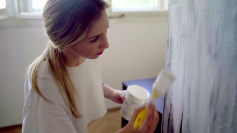 woman doing some home improvements - decoration stock videos & royalty-free footage