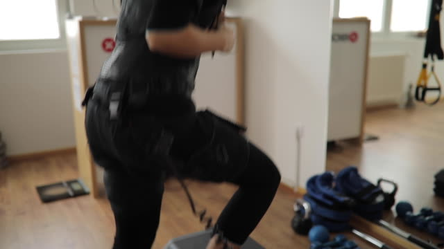 woman doing stepping exercise - step video stock e b–roll