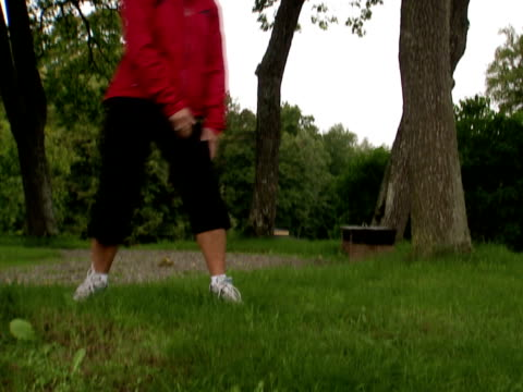 a woman doing stretching exercises stockholm sweden. - joggerin stock-videos und b-roll-filmmaterial