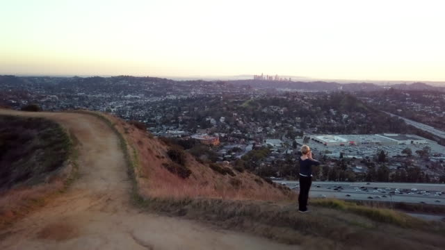 woman doing sun salutations - aerial drone shot - glendale california stock videos & royalty-free footage