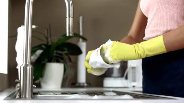 HD: Woman Doing The Dishes