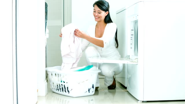 woman doing the laundry - laundry stock videos & royalty-free footage
