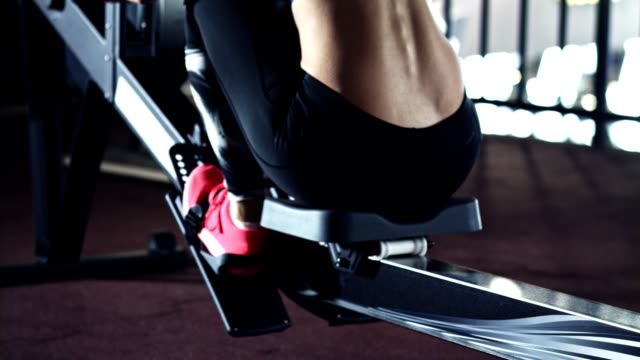 woman doing total body rowing workout - rowing machine stock videos & royalty-free footage