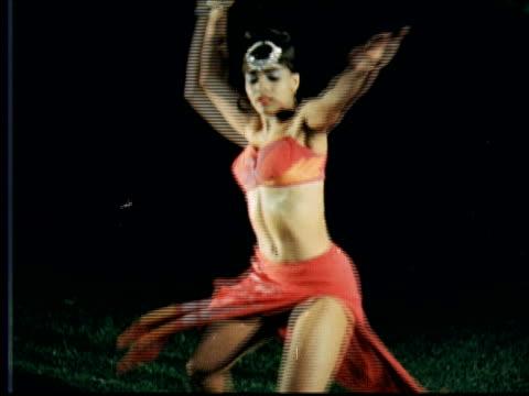 MS Woman doing wild modern dance to bongo drum music / Hamilton, Bermuda