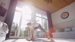Woman Doing Yoga and Stretching in Morning
