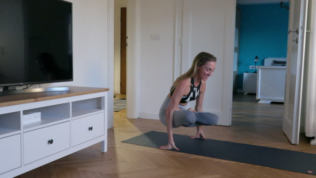 woman doing yoga in scale pose - lotus position stock videos & royalty-free footage