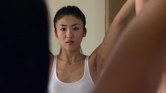 CU PAN Woman doing yoga in studio/ New York, NY