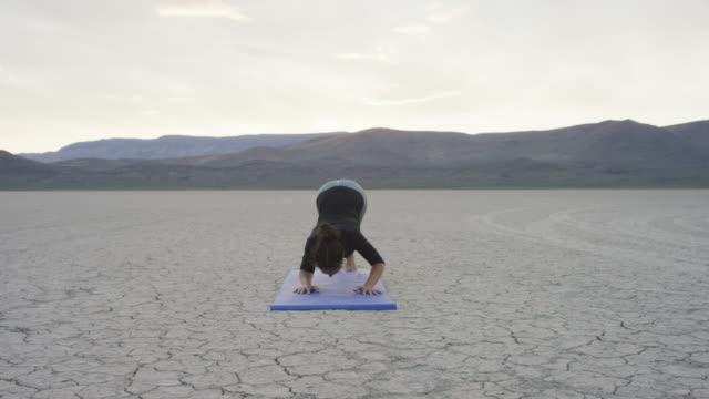 Woman doing yoga in the desert