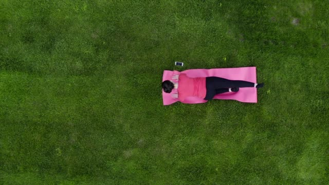 woman doing yoga in the garden - formal garden stock videos & royalty-free footage