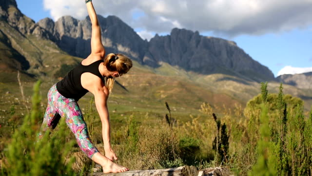 woman doing yoga in the mountains - good posture stock videos & royalty-free footage