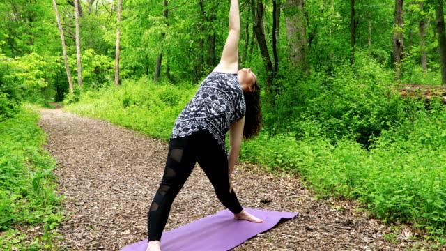 "Woman Doing Yoga - ""Trikonasana"" (""Triangle"")"