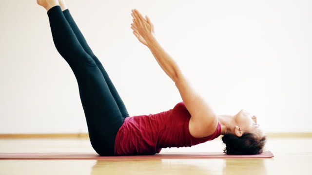 woman doing yoga - aufblenden stock-videos und b-roll-filmmaterial