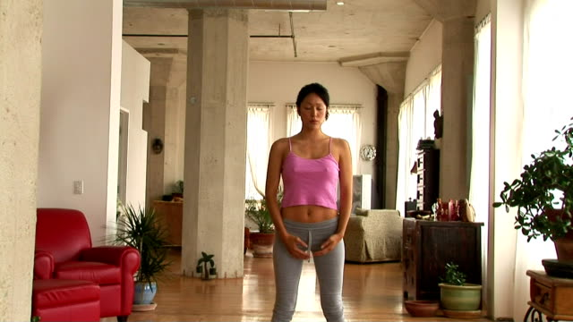 woman doing yoga - three quarter length stock videos & royalty-free footage